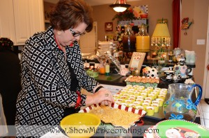 Tricia adds the last minute touches to the delicious Christmas brunch for the Miss Cayce's Christmas Store Mary Engelbreit and Mark Roberts Christmas Brunch