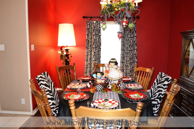 "The table is set, complete with a ""Vintage"" Mary Engelbreit girl centerpiece."