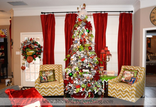 Bold red curtains, chevron chairs and a flocked tree pair perfectly with Mary Engelbreit ornaments and decorations.