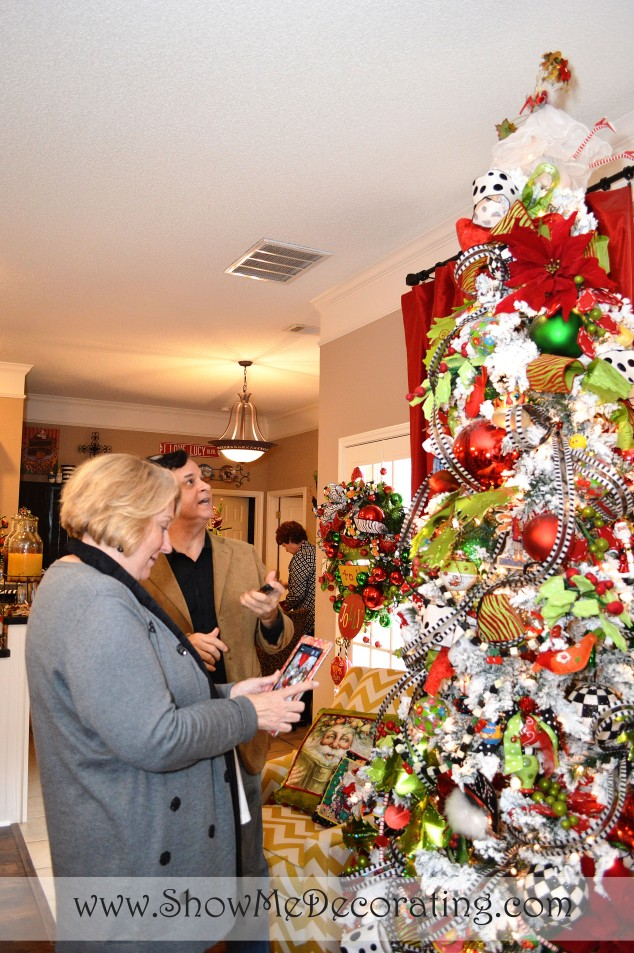 Mary Engelbreit and Mark Roberts admire many of the Vintage Mary Engelbreit decorations.