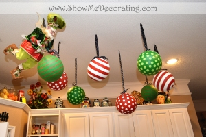 Paper mache balls hang from black and white polka dot ribbon and a Mark Roberts Fairy adds whimsy!