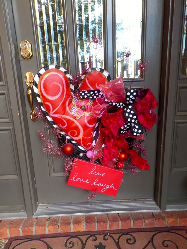 Lisa Frost heart is a great focal point on this grapevine wreath