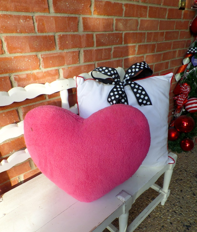 The inexpensive Fuzzy heart pillow pops against the white