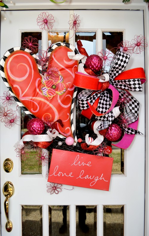 Guest are greeted with a beautiful wreath,Lisa Frost Heart banner, red, pink and black and white!