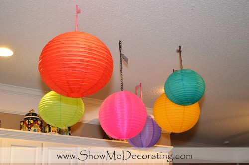 Paper lanterns float above the kitchen, hung from teacup hooks!
