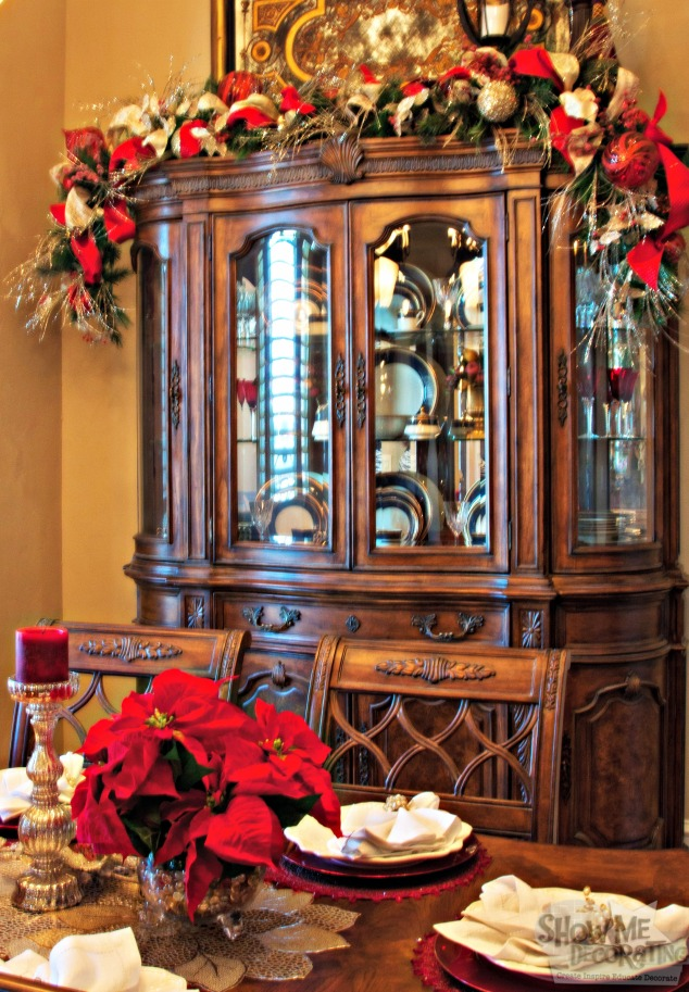 dining room christmas decor, hutch garland, christmas garland
